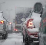 cars in traffic during snow storm