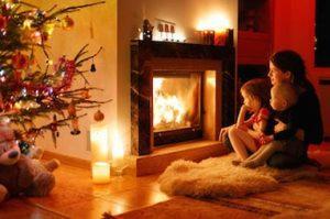 family around fireplace image
