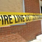 fire line tape across brick building after a fire