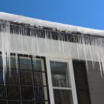 ice dam hanging off exterior of home