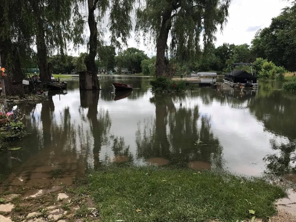 Yards and homes flooded due to recent heavy rains and storms spread all over Southern Wisconsin | Basement flooding and water damage restoration | Services by A&J Property Restoration DKI of Madison, Middleton, Sun Prairie, Waunakee, Milwaukee, WI Dells, Fort Atkinson, Watertown, and Waukesha, Wisconsin