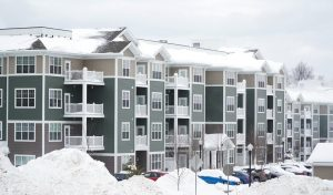 commercial apartment buildings covered in snow