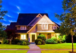 residential property at night with exterior lights on