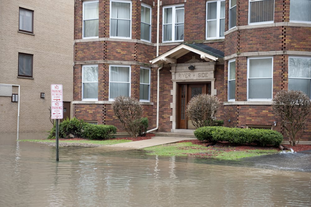 Brick building with flooded sidewalks