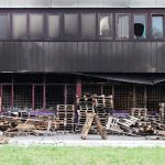 commercial warehouse damaged by fire with smoke and fire damage needing help from disaster restoration company